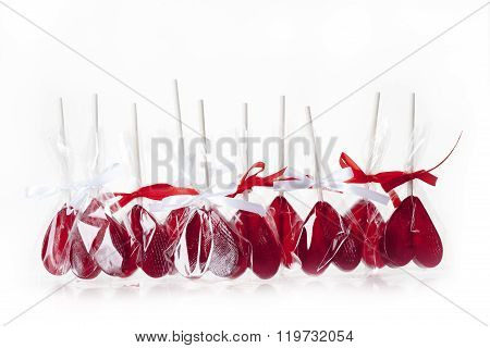Love concept. Red hearts lollipops