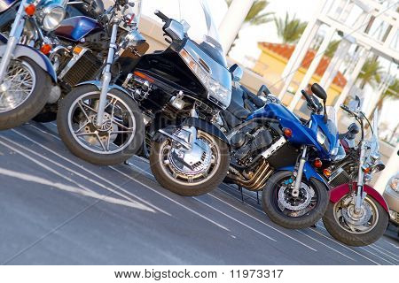 A group of motorcycles parked side by side.