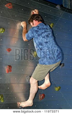 A man climbing a rock wall.