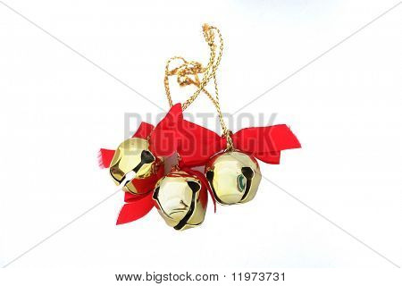 Three Christmas bells isolated on a white background.