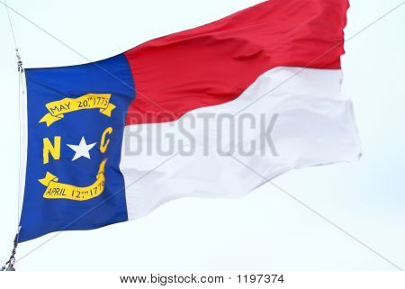 flag of north carolina waving in the wind poster