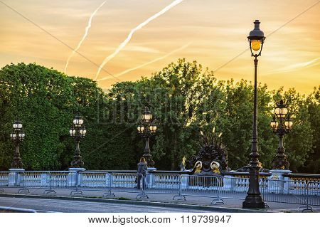 lone passerby on Alexander III bridge at dawn