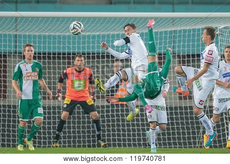 VIENNA, AUSTRIA - OCTOBER 29, 2014: Stefan Schwab (#8 Rapid) tries to score a goal in an Austrian soccer league game.