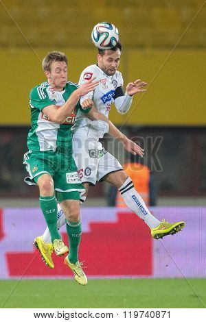 VIENNA, AUSTRIA - OCTOBER 29, 2014: Marco Djuricin (#9 Sturm) and Robert Beric (#9 Rapid) fight for the ball in an Austrian soccer league game.