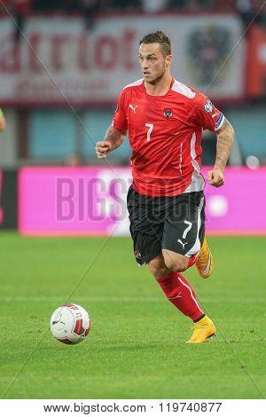 VIENNA, AUSTRIA - OCTOBER 12, 2014: Marko Arnautovic (#7 Austria) runs with the ball in an European Championship qualifying game.