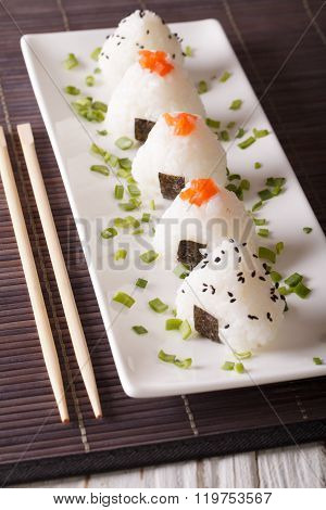 Japanese Food Onigiri Rice Balls Close-up On A Plate. Vertical