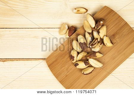 Brazil nut on a white background (Bertholletia excelsa), blanched close up isolated on the table on