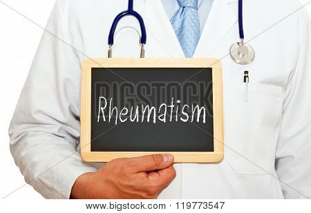 Rheumatism - doctor holding chalkboard with text on white background