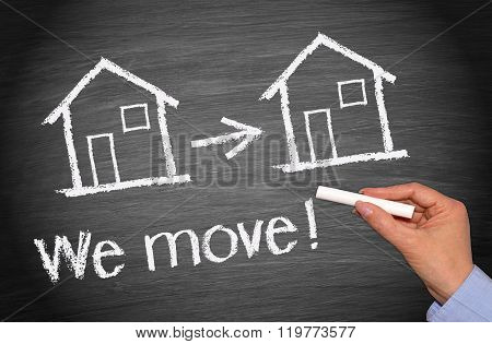 We move - chalkboard with two houses - real estate