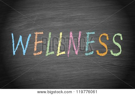 Wellness - word or text on chalkboard background