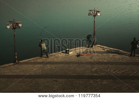 Fishermen On The City Waterfront