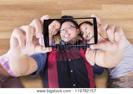Father And His Children Taking Selfie
