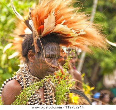 Native tribe woman wearing feathers in village ritual dance