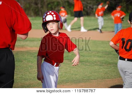 Cute little baseball boy during game.