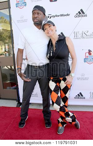 Ricky Smith and Paula Trickey arrive at the inaugural Stephen Bishop celebrity golf invitational benefiting R.A.K.E. on Feb. 15, 2016 at Calabasas Country Club in Calabasas, CA.