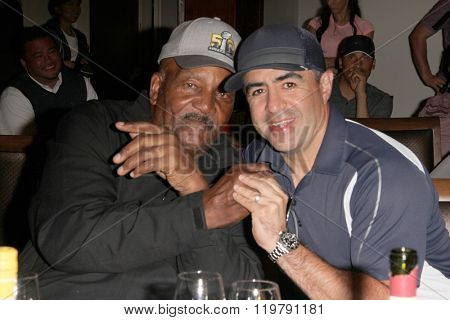 Jim Brown and Jose Alvarado at dinner during the Inaugural Stephen Bishop celebrity golf invitational benefiting R.A.K.E. on Feb. 15, 2016 at Calabasas Country Club in Calabasas, CA.