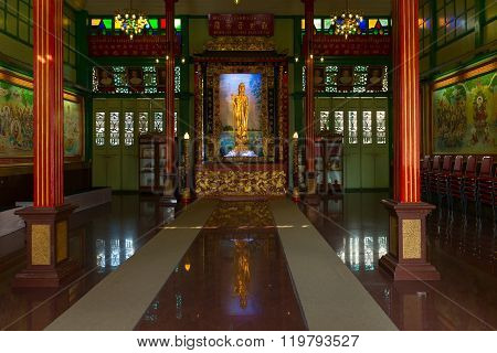 Temple Interior With A Golden Kuan Yin Statue In Bangkok