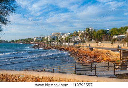 Golden coastline of Ibiza as seen from St Antoni de Portmany, Ibiza,  Balearic sea churning waves on
