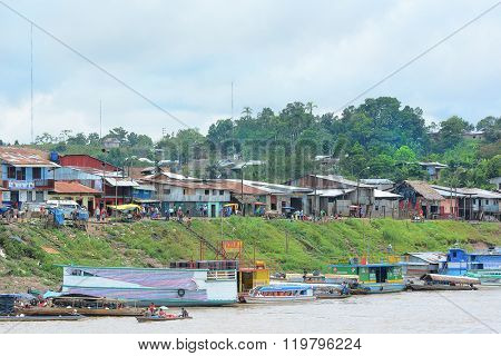 NAUTA, PERU - OCTOBER 14, 2015: Nauta, Peru seen for a boat on the Maranon River. Nauta is the 2nd largest city in the Peruvian Amazon.