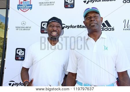 Ricky Smih and Dennis Haysbert arrives at the inaugural Stephen Bishop celebrity golf invitational benefiting R.A.K.E. on Feb. 15, 2016 at Calabasas Country Club in Calabasas, CA.