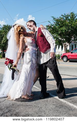 Zombie Bride And Groom Pose At Atlanta Pub Crawl Event