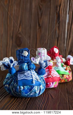 Traditional Russian folk textile doll. Natural grass and cotton fabrics