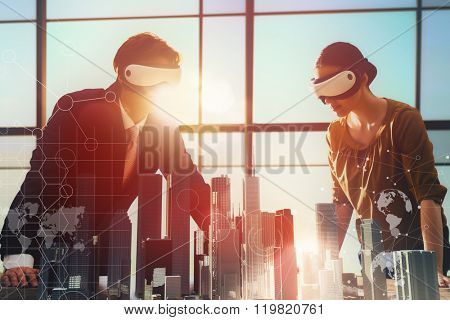 two business persons are developing a project using virtual reality goggles. the concept of technologies of the future