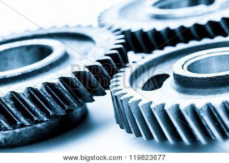 Gears, grunge cogwheels, real engine elements on white. Heavy industry, concepts of teamwork, construction, connect.