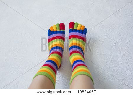 Close-up Photo Woman's Feet In Multi Color Socks