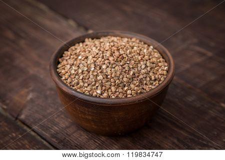 Buckwheat Groats On Dark Wooden Table