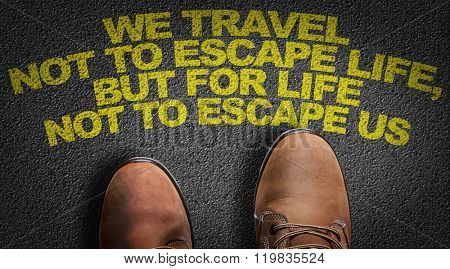 Top View of Business Shoes on the floor with the text: We Travel Not To Escape Life, But For Life Not To Escape Us