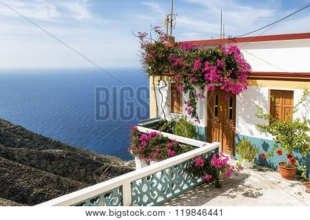 poster of Beautiful House on the cliff in Olympos Karpathos island Greece