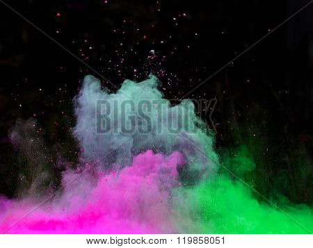 Explosion of colorful powder, isolated on black background