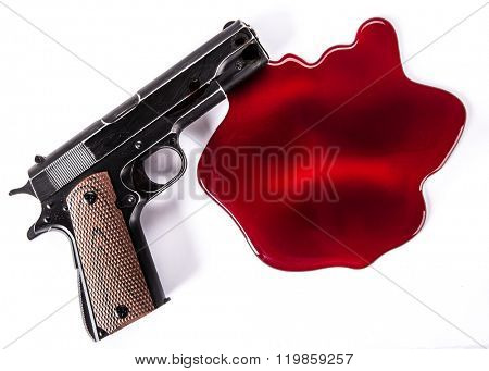 Murder concept - gun with blood on white background, close-up.
