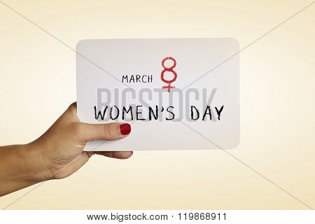 the hand of a young woman with red polished nails holds a signboard with the text march 8 womens day, with the number eight as the female gender symbol poster