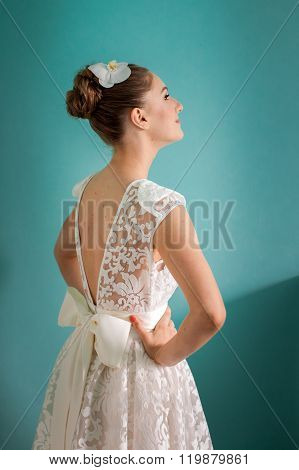Young bride with hands on hips
