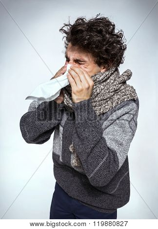 Man Holding A Tissue On His Nose