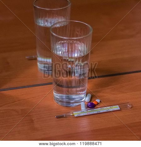 Thermometer, Pills And Glass Of Water