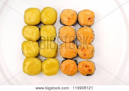 Set Of Baked Cheese Rools On White Plate
