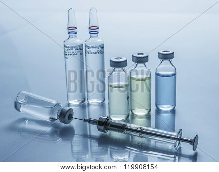 Medicine Vials And Syringe