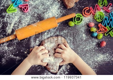 Young Girl's Hands Kneading Dough
