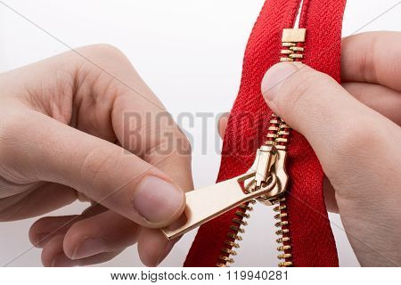 Hand holding color zipper