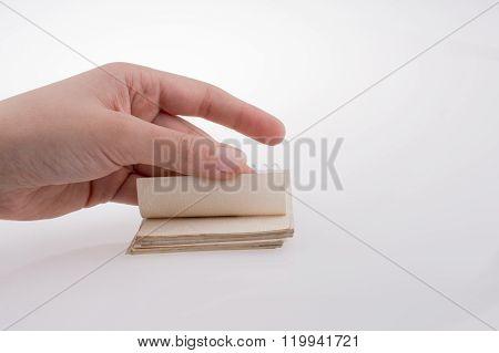 Hand holding a spiral notebook