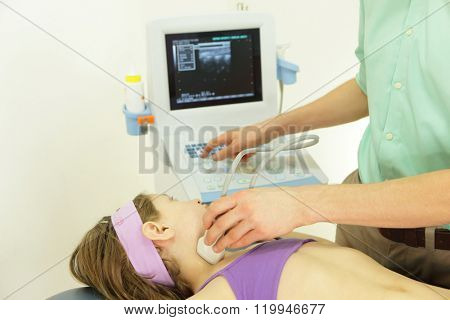 girl's neck diagnosis carried out with the use of an ultrasound
