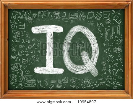 IQ Concept. Green Chalkboard with Doodle Icons.