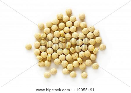 A pile of folic acid vitamin supplement tablets isolated on a white background from above. poster