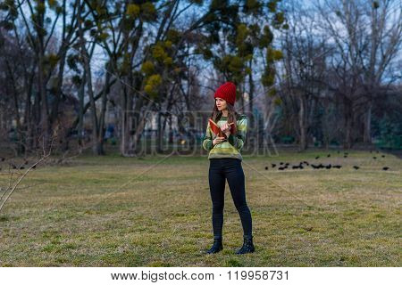 Blue Sky, Red Hat And Green Sweater.
