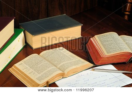 the new testament opened to john 3:16 with study notes and materials poster