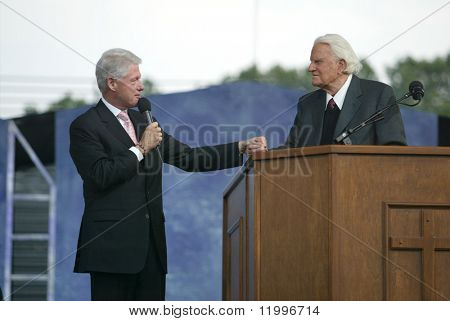 NEW YORK - JUNE 25: Former U.S. President Bill Clinton (L) speaks with Rev. Billy Graham at the Greater New York Billy Graham Crusade June 25, 2005 in Flushing, New York.