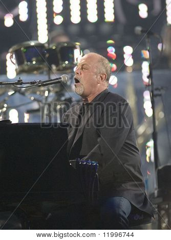FLUSHING, NY - JULY 16: Singer Billy Joel performs at Shea Stadium on July 16, 2008 in Flushing, New York.